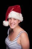 Schönes lächelndes Weihnachtsmädchen, auf Schwarzem stockfotos
