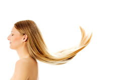 Schönes langes blondes Haar, lokalisiert auf Weiß Lizenzfreies Stockfoto