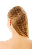 Schönes langes blondes Haar, lokalisiert auf Weiß Stockfotografie
