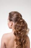 Schönes langes wellenförmiges Haar Rückseitige Ansicht Stockbild