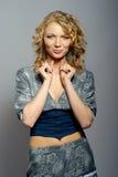 Schönes lockiges blondes Mädchen Lizenzfreies Stockfoto