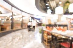 Schönes Luxuseinkaufszentrum der abstrakten Unschärfe und Einzelhandelsgeschäft Stockbild