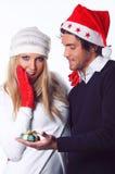 Schönes Mädchen überrascht für Weihnachtsgeschenk Lizenzfreie Stockfotos
