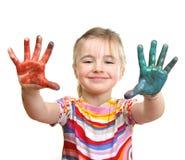 Schönes Mädchen, das mit Farben spielt Stockfotografie