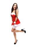 Schönes Mädchen, das Weihnachtsmann-Kleidung trägt Stockfoto