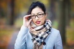 Schönes Mädchen in den Gläsern Lizenzfreie Stockfotografie