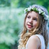 Schönes Mädchen der Erstkommunion Lizenzfreies Stockfoto