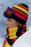 Schönes Mädchen in der Skifahrenschablone Stockfotografie
