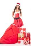 Schönes Mädchen in der Weihnachtsmann-Klage Stockfotos