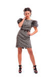 Schönes Mädchen in einem grauen Kleid Stockbilder