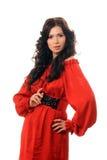 Schönes Mädchen in einem roten Kleid auf einem weißen Hintergrund. Lizenzfreie Stockbilder