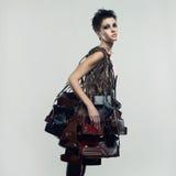 Schönes Mädchen in einem ungewöhnlichen Kleid Stockfotos