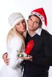 Schönes Mädchen gerichtet auf ihr Weihnachtsgeschenk Stockfotos