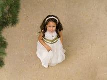 Schönes Mädchen in ihrer ersten Kommunion Lizenzfreies Stockfoto