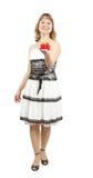 Schönes Mädchen im Kleid mit Geschenk, Studio getrennt Lizenzfreie Stockfotos