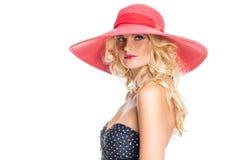 Schönes Mädchen im roten Hut Lizenzfreies Stockbild