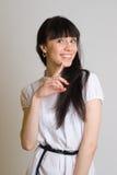 Schönes Mädchen im Weiß Stockbild