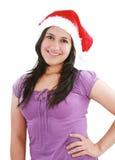 Schönes Mädchen im Weihnachtsmann-Hut lizenzfreies stockbild