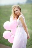 Schönes Mädchen mit Ballonen Stockfotos
