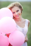 Schönes Mädchen mit Ballonen Stockfoto
