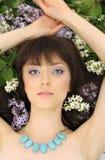 Schönes Mädchen mit Blumen Lizenzfreie Stockbilder