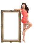 Schönes Mädchen mit dem Bilderrahmen lokalisiert auf Weiß Lizenzfreie Stockfotografie