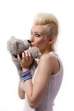 Schönes Mädchen mit dem blonden Haar und Teddybären Stockfoto