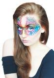 Das Mädchen in einer Maske Stockfotografie