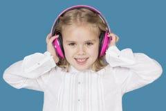 Schönes Mädchen mit dem Kopfhörerlächeln Lizenzfreie Stockfotografie