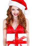 Schönes Mädchen mit einem Geschenk auf einem weißen Hintergrund Stockbild