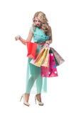 Schönes Mädchen mit Einkaufenbeuteln Stockbilder