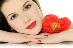 Schönes Mädchen mit Mohnblume Lizenzfreies Stockbild