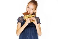 Schönes Mädchen mit Schokolade stockbilder