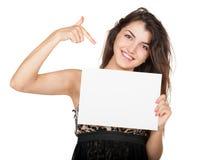 Schönes Mädchen und leerer weißer freier Raum Lizenzfreie Stockfotos