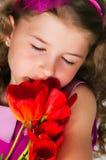 Schönes Mädchen und Tulpen Lizenzfreies Stockbild