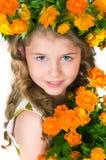Schönes Mädchen und wilde Blumen Lizenzfreies Stockbild