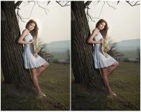 Schönes Mädchenporträt mit Hut nahe einem Baum im Garten. Junge kaukasische sinnliche Frau in einer romantischen Landschaft. Geumg Lizenzfreie Stockfotos