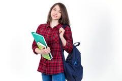 Schönes Mädchenschulmädchen, Student mit Lehrbüchern und Rucksack Lizenzfreies Stockbild
