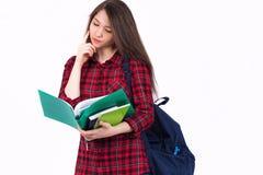Schönes Mädchenschulmädchen, Student mit Lehrbüchern und Rucksack Lizenzfreie Stockfotos