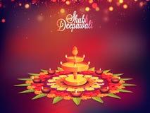 Schönes Rangoli mit Lit-Lampen für Diwali Stockbild