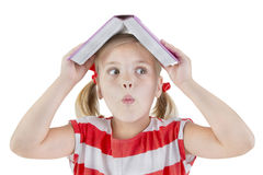 Schönes Schulmädchen hält Buch Stockfotografie
