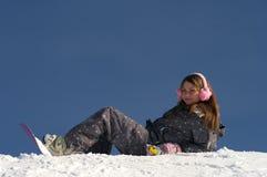 Schönes Snowboardermädchen stockfotografie