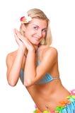 Schönes Tanzenmädchen mit einer Blume in ihrem Haar Stockbilder