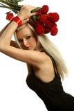 Schönes und reizvolles Mädchen mit einem roten Bogen Lizenzfreie Stockbilder