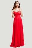 Schönes weibliches Art und Weisebaumuster im roten Kleid Lizenzfreies Stockbild