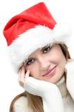 Schönes Weihnachtsmädchen im Sankt-Hut Stockbilder