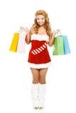 Schönes Weihnachtsmädchen lokalisiert auf dem weißen Hintergrund, der bunte Pakete hält Lizenzfreies Stockbild