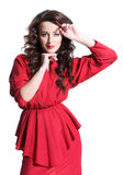 Schönes Mädchen in einem roten Kleid Lizenzfreie Stockfotografie