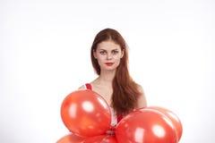 Schönheit auf Weiß lokalisierte rote Ballone der Hintergrundgriffe, Feiertag, Leerstelle für Kopie Lizenzfreie Stockfotos