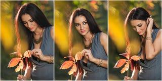 Schönheit in der grauen Aufstellung im herbstlichen Park Junge Brunettefrau, die ein Blatt hält und Zeit im Herbst verbringt Stockbilder